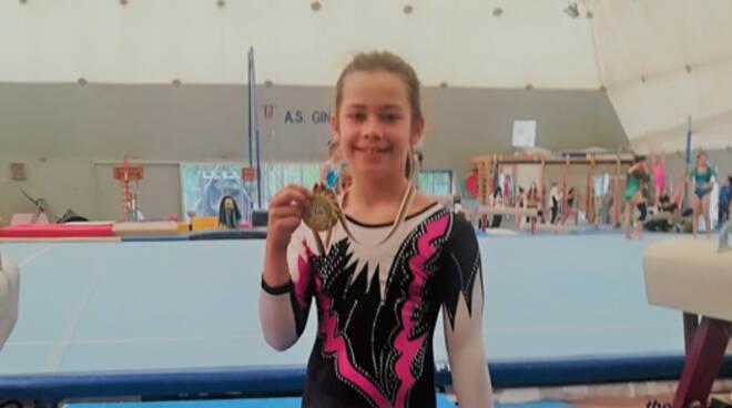 Ginevra Terminiello conquista il campionato regionale Silver LD A3 di ginnastica artistica. Gioia anche a Praiano